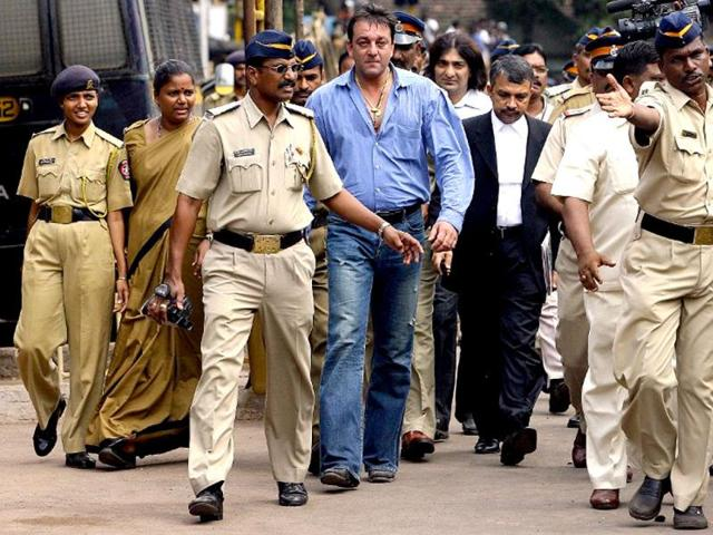 Policemen-escort-actor-Sanjay-Dutt-as-he-comes-out-of-the-Terrorist-And-Disruptive-Activities-Protection-Act-TADA-court-during-the-first-day-of-verdicts-in-the-1993-bomb-attacks-case-in-Mumbai-on-12-September-2006-AFP