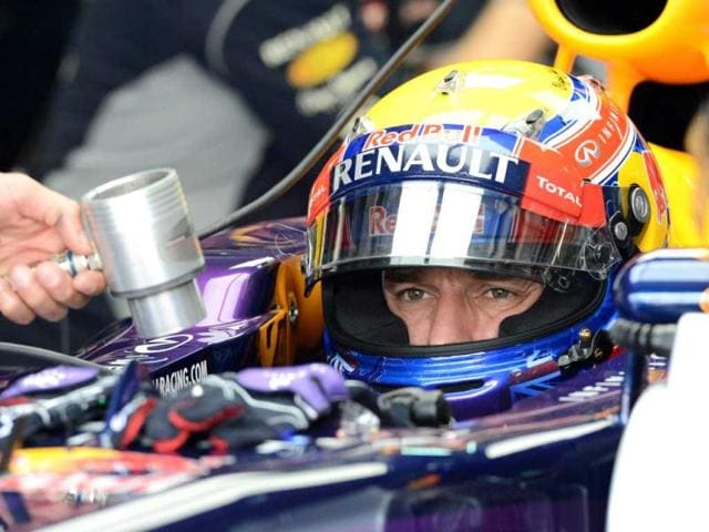 Red-Bull-driver-Mark-Webber-of-Australia-sits-in-his-the-race-car-during-the-first-practice-session-of-the-Formula-One-Malaysian-Grand-Prix-at-Sepang-AFP-photo