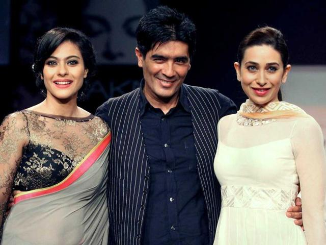 Kajol-L-and-Karishma-Kapoor-showcase-creations-by-designer-Manish-Malhotra-C-during-a-fashion-show-on-the-first-day-of-Lakme-Fashion-Week-LFW-Summer-Resort-2013-AFP-Photo