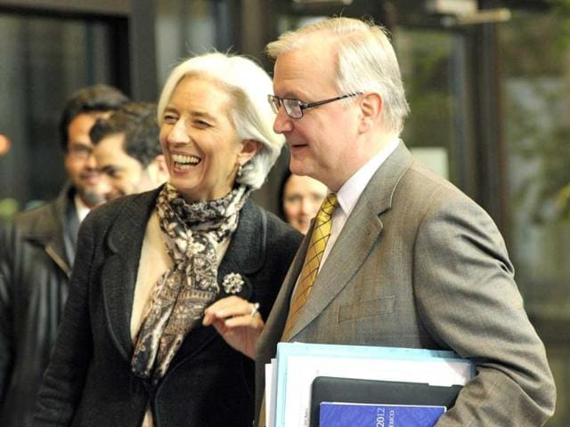EU-commissioner-for-economic-and-monetary-affairs-Olli-Rehn-R-and-International-Monetary-Fund-IMF-managing-director-Christine-Lagarde-L-leave-following-a-Eurozone-meeting-at-EU-headquarters-in-Brussels-AFP-photo