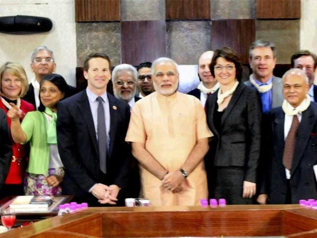 A-high-level-delegation-comprising-of-MPs-and-noted-industrialists-from-United-States-calling-on-Gujarat-Chief-Minister-Narendra-Modi-in-Gandhinagar-PTI-Photo