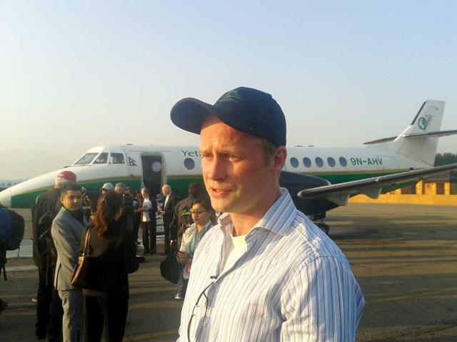 Charles-Douglas-Hamilton-before-the-80th-anniversary-flight-in-Kathmandu-airport-In-the-background-is-the-Jetsream-41-aircraft-used-for-the-flight-Photo-Utpal-Parashar