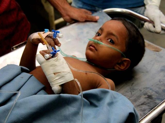 Rescue-workers-carry-a-child-who-survived-the-building-collapse-in-Thane-Reuters