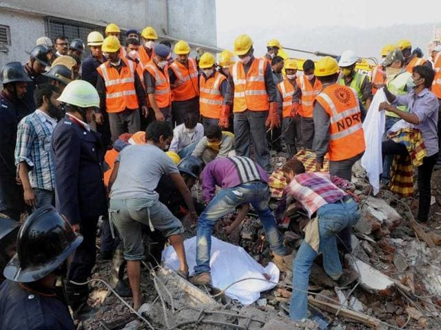 Rescue-workers-use-a-stretcher-to-carry-the-body-of-a-victim-across-the-rubble-after-the-collapse-of-a-building-in-Thane-Mumbai-Reuters