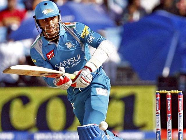 Pune Warriors batsman Marlon Samuels plays a shot against Kings IX Punjab during their IPL match in Pune o Sunday. PTI/Shashank Parade