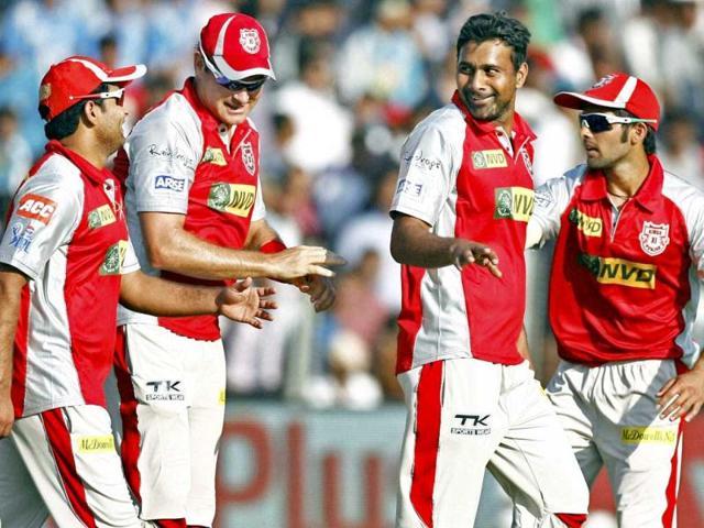 Kings XI Punjab bowler Praveen Kumar celebrates after dismissal of Pune Warriors batsman Ross Taylor during their IPL match in Pune on Sunday. PTI/Shashank Parade