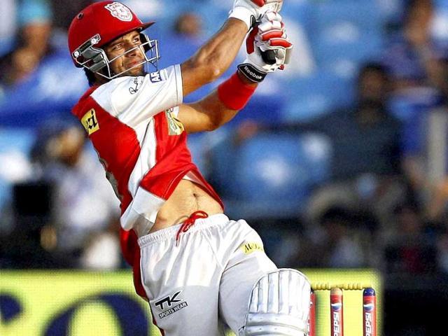 Kings XI Punjab batsman Manan Vohra plays a shot agaisnt Pune Warriors during their IPL match in Pune on Sunday. PTI Photo/Shashank Parade