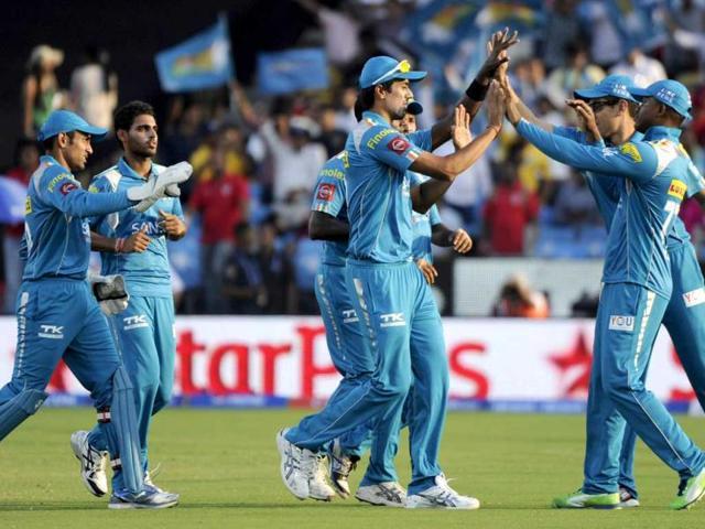 Pune Warriors India fielders celebrate the wicket of Kings XI Punjab batsman Adam Gilchrist during the Pepsi IPL T20 cricket match at the Subrata Roy Sahara Stadium.in Pune. HT Photo/Vijayanand Gupta