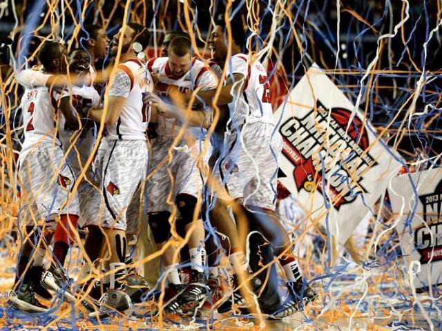 The Louisville Cardinals celebrate after they won 82-76 against the Michigan Wolverines during the 2013 NCAA Men's Final Four Championship at the Georgia Dome in Atlanta, Georgia. (AFP Photo)