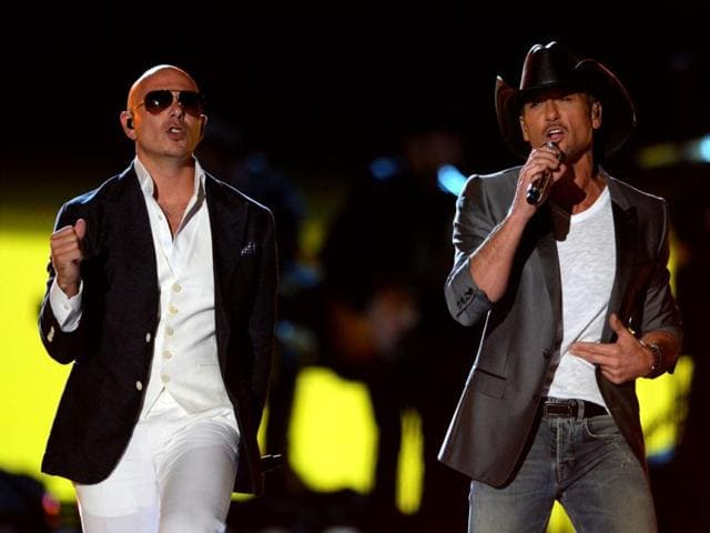 Pitbull, left, and Tim McGraw perform at ACM Presents: Tim McGraw's Superstar Summer Night at the MGM Grand Garden Arena in Las Vegas. (AP Photo)