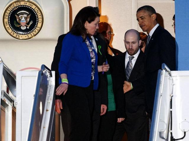 President Barack Obama stands in the door of Air Force One, top right, at Andrews Air Force Base, Md., with families who lost relatives in the Sandy Hook Elementary School shooting. (AP Photo)