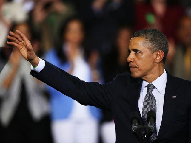 US President Barack Obama travels to Connecticut to advocate passing of stricter gun laws. (AFP Photo)
