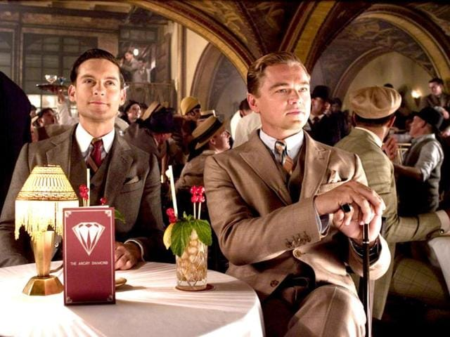 The film is about Nick Caraway (Maguire), a Midwestern war veteran who finds himself drawn to the past and the lifestyle of his millionaire neighbour, Jay Gatsby, played by Leonardo DiCaprio (right).