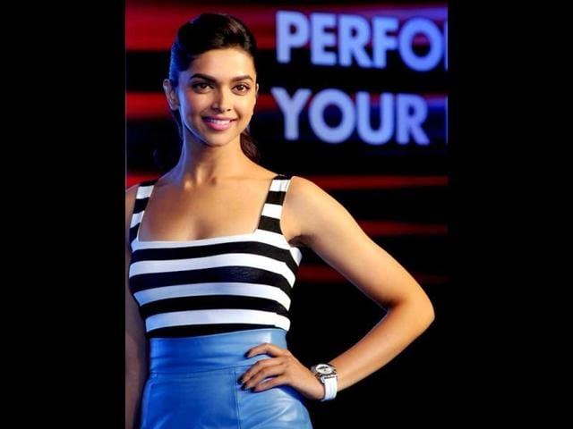 Bollywood-actress-Deepika-Padukone-poses-during-the-launch-of-a-timepiece-by-Tissot-in-Mumbai-on-April-8-2013-AFP-Photo
