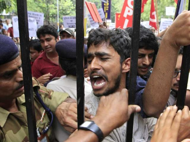 West-Bengal-finance-minister-Amit-Mitra-was-heckled-and-had-his-shirt-torn-off-by-Students-Federation-of-India-activists-outside-the-planning-commission-in-New-Delhi-HT