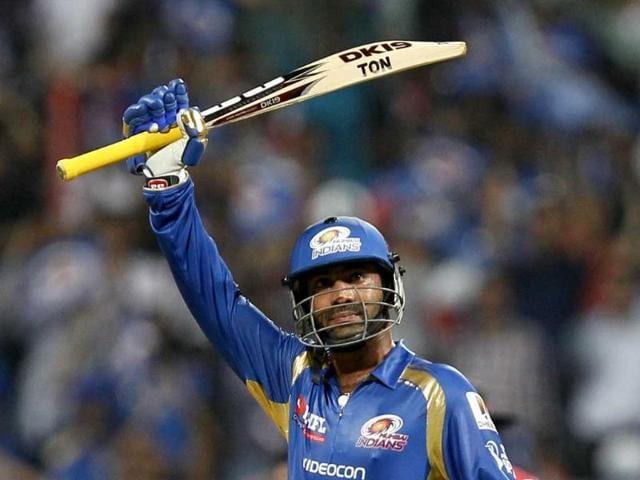 Mumbai-Indians-batsman-Dinesh-Karthik-celebrates-his-half-century-during-the-T20-match-between-Mumbai-Indians-and-Delhi-Daredevils-at-Wankhede-Stadium-Mumbai-HT-Photo-Satish-Bate