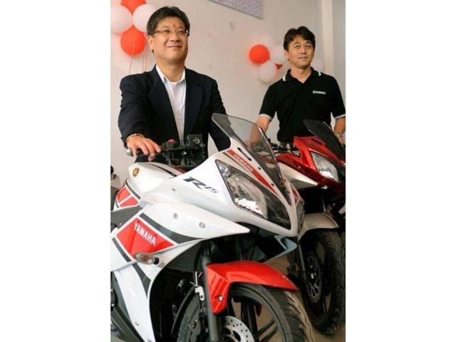Yamaha-chief-executive-officer-and-managing-director-Hiroyuki-Suzuki-L-and-director-and-chief-sales-officer-Jun-Nakata-Photo-AFP
