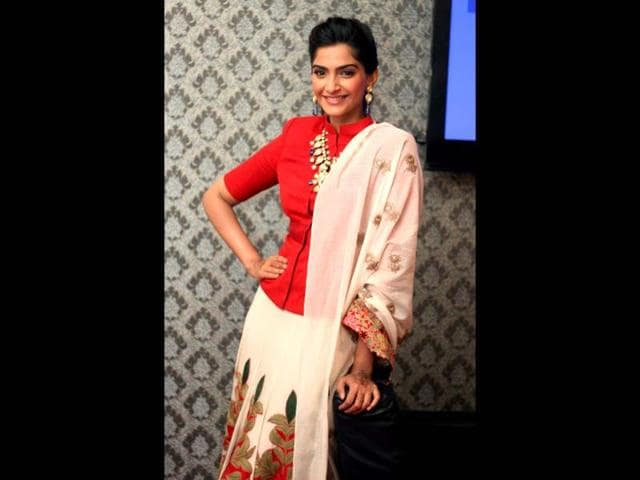 Bollywood fashion,cleavage showing dresses,high-neck blouses
