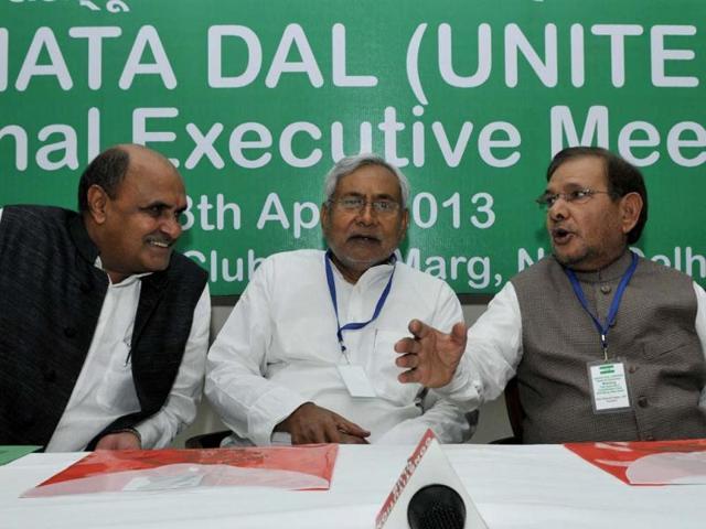 Bihar-chief-minister-and-Janata-Dal-U-leader-Nitish-Kumar-C-with-party-president-Sharad-Yadav-and-KC-Tyagi-during-the-party-s-national-exicutive-meeting-in-New-Delhi-HT-Photo-Mohd-Zakir