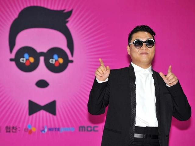 South-Korean-rapper-Psy-in-a-checkered-jacket-performs-his-new-song-Gentleman-in-his-concert-titled-Happening-in-Seoul-AP-Photo