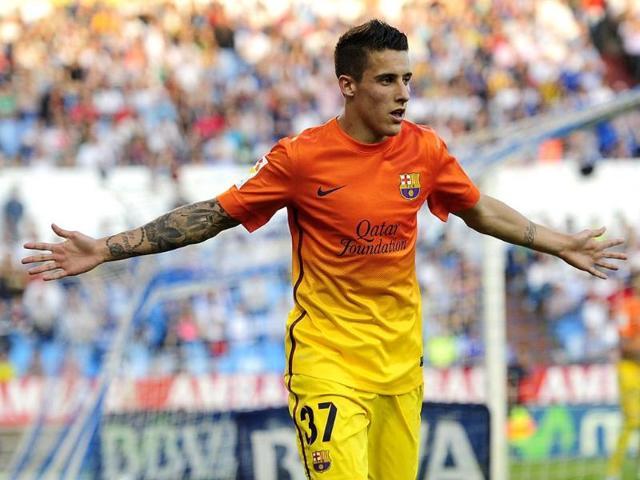 Barcelona-s-Cristian-Tello-reacts-after-scoring-against-Zaragoza-during-a-Spanish-La-Liga-soccer-match-at-the-Romareda-stadium-in-Zaragoza-Spain-AP-Photo