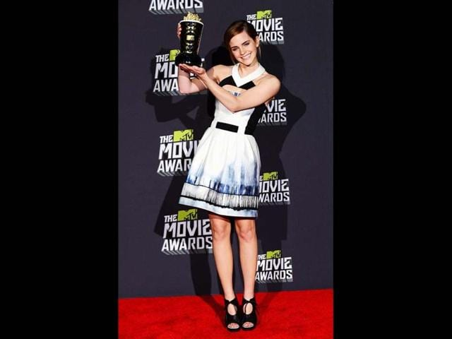 Actress-Emma-Watson-winner-of-the-MTV-Trailblazer-Award-poses-in-the-press-room-at-the-2013-MTV-Movie-Awards-in-Los-Angeles-California-on-April-14-2013---AFP-Photo