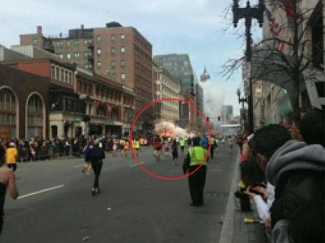 A-TV-grab-shows-people-at-the-finish-line-of-the-2013-Boston-Marathon-following-an-explosion-in-Boston