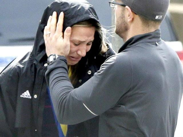 A-Boston-Marathon-runner-is-comforted-as-she-cries-in-the-aftermath-of-two-blasts-which-exploded-near-the-finish-line-of-the-Boston-Marathon-in-Boston-AP-Photo