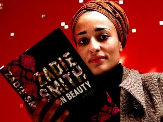 File-photo-British-author-Zadie-Smith-poses-with-her-book-On-Beauty-in-London-AP-Photo