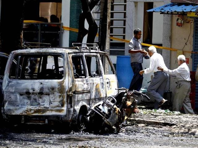 A-police-officer-inspects-the-site-of-the--bomb-blast-near-the-BJP-office-in-Bangalore-AP