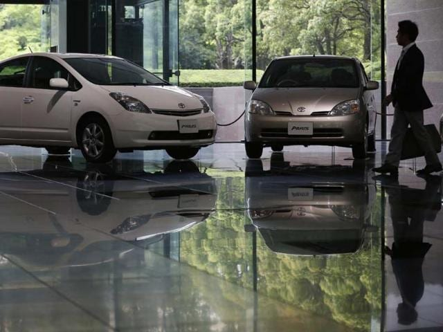A-man-walks-by-Toyota-Motor-Corp-s-successive-models-of-Prius-hybrid-cars-at-the-company-s-showroom-in-Tokyo-April-17-2013-Toyota-Motor-Corp-has-sold-more-than-5-million-gasoline-electric-hybrid-vehicles-as-of-the-end-of-March-since-they-first-went-on-sale-in-1997-the-automaker-said-on-Wednesday-Its-Prius-series-accounted-for-about-70-percent-of-that-making-it-the-most-popular-hybrid-model-in-the-automotive-industry-Photo-Reuters-Issei-Kato