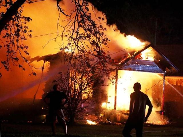A-person-looks-on-as-emergency-workers-fight-a-house-fire-after-a-near-by-fertilizer-plant-exploded-in-West-Texas-AP