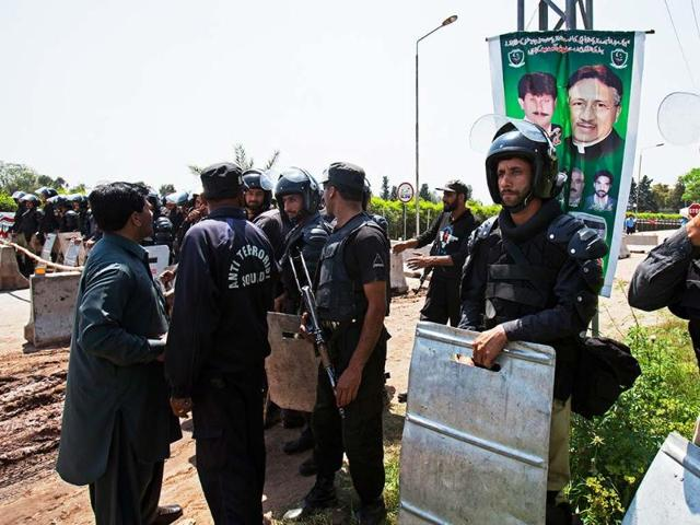 Pakistan police officers stand alert outside the house of Pakistan