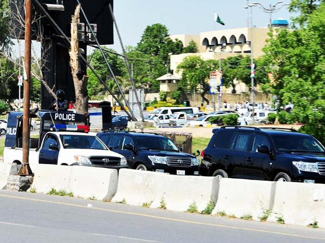 The motorcade of former military ruler Pervez Musharraf drives past following a high court hearing in Islamabad. A Pakistani court ordered the arrest of former military ruler Pervez Musharraf for his controversial decision to dismiss judges when he imposed emergency rule in 2007, officials said. AFP