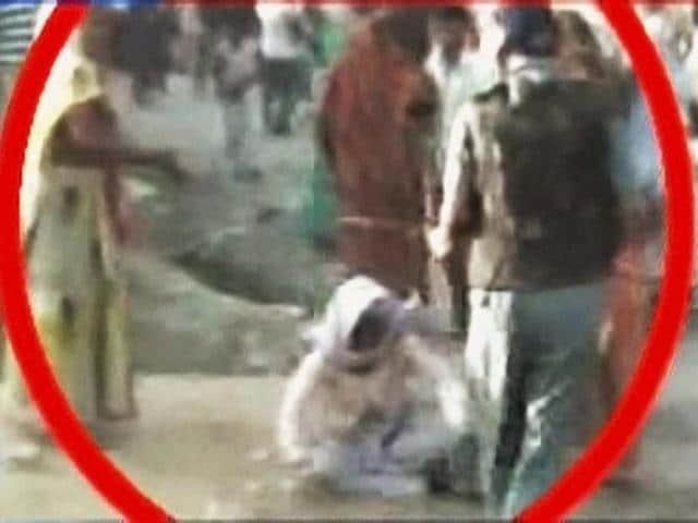 An-old-woman-who-was-thrashed-by-a-cop-during-a-demonstration-over-the-alleged-rape-and-murder-of-a-six-year-old-girl-in-Aligarh-Uttar-Pradesh-PTI-Photo-TV-grab