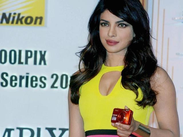 Priyanka-Chopra-poses-with-the-new-range-of-Nikon-s-Coolpix-camera-Photo-UNI