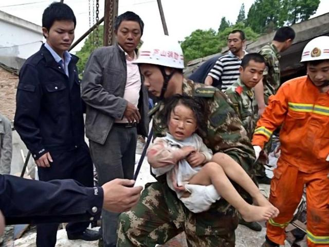 A-rescuer-C-carries-a-child-to-safety-after-she-was-pulled-out-of-her-collapsed-home-after-an-earthquake-hit-Ya-an-City-in-Lushan-county-southwest-China-s-Sichuan-province-AFP-PHOTO