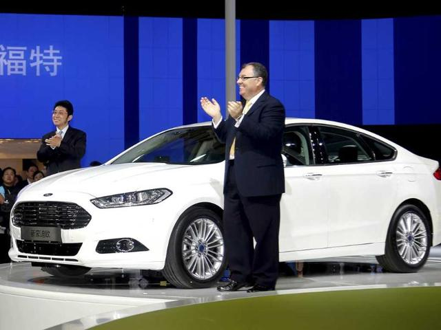 Changan Ford Mazda Automobile Co, Ltd. executive vice president Luo Minggang and its president Marin Burela applaud after they unveiled the new Ford Mondeo model at the Shanghai International Automobile Industry Exhibition media day in Shanghai. AP