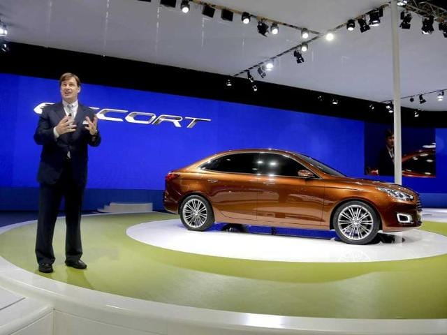 Ford Motor Co executive vice president of global marketing, sales and service and Lincoln, Jim Farley, speaks to the media after unveiling the new Ford Escort model at the Shanghai International Automobile Industry Exhibition media day in Shanghai. AP