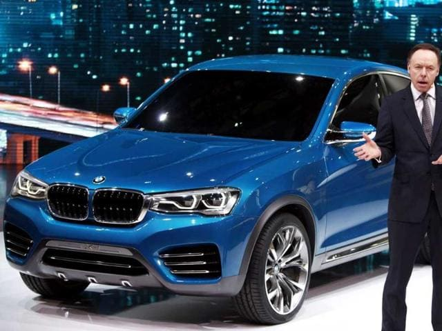 BMW sales chief Ian Robertson speaks next to a BMW Concept X4 vehicle during the opening day of the 15th Shanghai International Automobile Industry Exhibition in Shanghai. Reuters