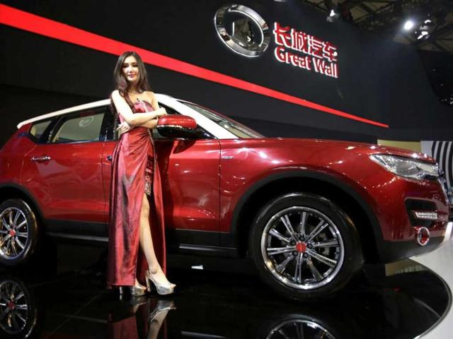 A model poses with Great Wall H7 SUV at the Shanghai International Automobile Industry Exhibition media day in Shanghai, China. AP