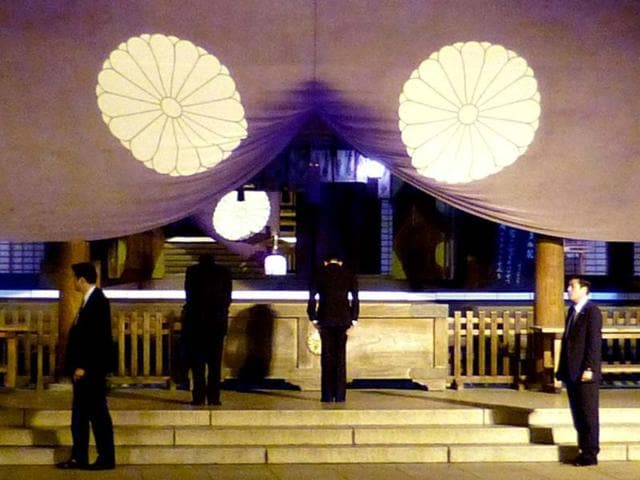 Japan-s-Deputy-Prime-Minister-and-Finance-Minister-Taro-Aso-offers-a-prayer-for-war-dead-as-he-visits-the-controversial-Yasukuni-shrine-in-Tokyo-in-the-evening-after-returning-from-Washington-Three-Japanese-cabinet-ministers-visited-Tokyo-s-Yasukuni-war-shrine-while-Prime-Minister-Shinzo-Abe-has-dedicated-equipment-used-in-rituals-in-moves-likely-to-anger-China-and-South-Korea-AFP