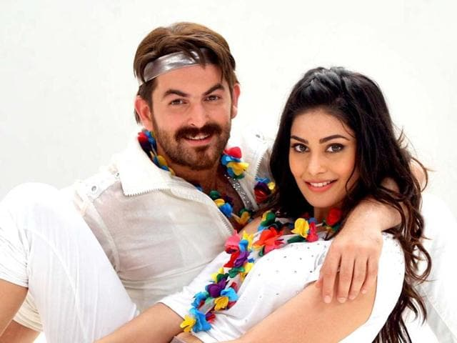 Neil-Nitin-Mukesh-and-Puja-Gupta-pose-for-a-photo-during-a-promotion-for-the-upcoming-romantic-thriller-Shortcut-Romeo-AFP-Photo