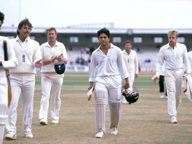 A young Sachin is applauded by England players as he walks off the field after a Test match. (Getty Images)