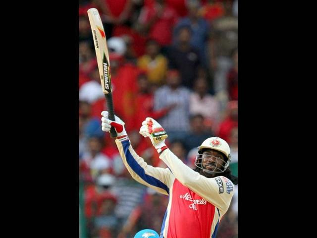 Royal Challengers Bangalore player Chris Gayle plays a shot against Pune Warriors during the T20 match at Chinnaswamy Stadium in Bangalore. (PTI)