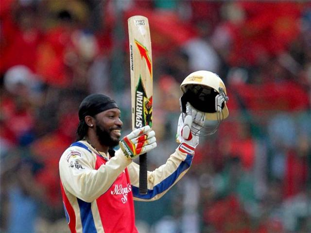 Royal Challengers Bangalore player Chris Gayle celebrates his century during the T20 match against Pune Warriors at Chinnaswamy Stadium in Bangalore. (PTI)
