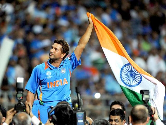 Sachin waves the Indian tricolour as he celebrates his team