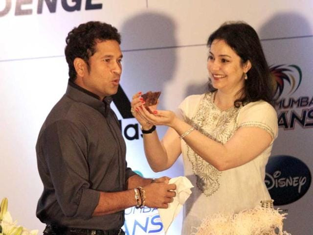 Anjali Tendulkar, wife of Sachin Tendulkar, offers him a piece of cake during his 40th birthday celebrations in Kolkata, India. (AP Photo)