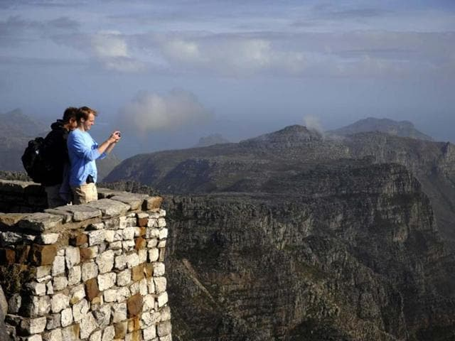 Tourists-take-pictures-from-the-south-side-of-Table-Mountain-in-Cape-Town-South-Africa-Photo-AFP-Gianluigi-Guercia