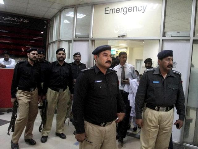 Pakistani police officers stand guard at an emergency ward where Sarabjit Singh is admitted at a local hospital in Lahore, Pakistan. AP